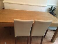 Teak dinning table and 4 cream leather chairs