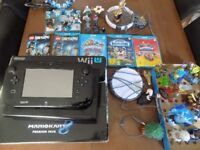 wii u console boxed with 4 games loads of sky landers and dimensions figures look cheap