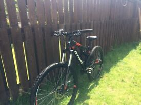 Full suspension mountain bike btwin