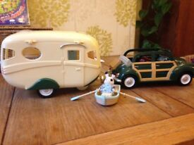 As new sylvanians car, caravan,rowboat includes sylvanians bunny & includes loads of accessories