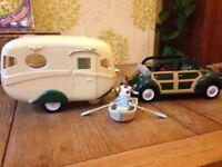 As new sylvanians car, caravan,rowboat includes sylvanians bunny & includes loads of accessories