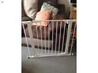 Baby safety gate with either side extensions for sale