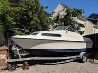 Boat Shetland 4 for sale, 18ft long with a trailer.