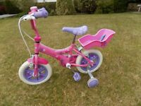 First size child's bicycle with stabilisers