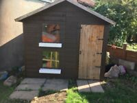 6ft x 8ft wooden playhouse