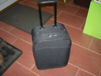 Cabin suitcase in black 50x33x23 cm approx handle and wheels