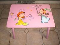 Beautiful glossy pink wooden table for girl's room Princess