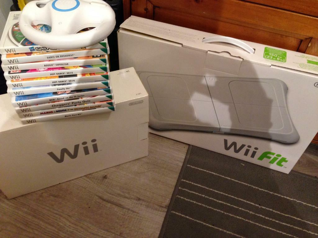 Nintendo Wi console and Wi fit board and