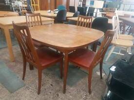 G-plan extendable table and four chairs set