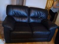 2x2 black leather sofa