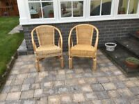 Two nice condition cane chairs. Matching pair.
