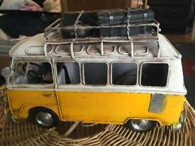 Camper van and beetle