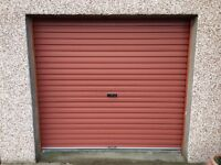 Terracotta coloured roller garage door