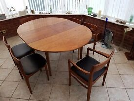 Round extending veneered table and 6 chairs, 2 of which are carvers. Beautiful condition.