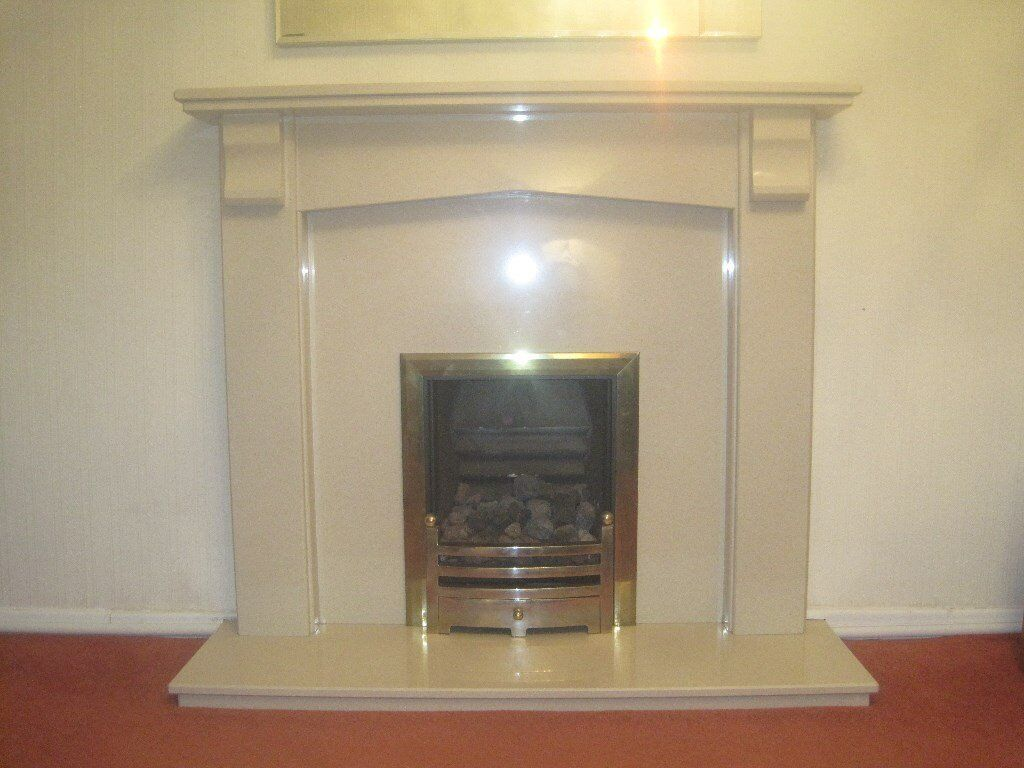 marble cream fire surround and gas coal fire in stalybridge