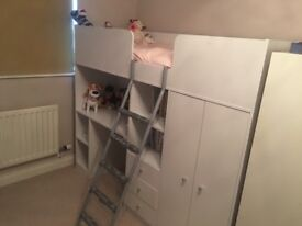 Child's bunk bed with desk and wardrobe