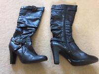 Brand new black knee high boots