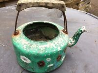 Old painted kettle was used as a planter