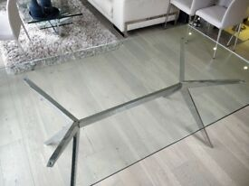 Clear glass dining table with chrome legs