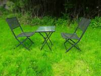 Metal garden table and 2 matching chairs