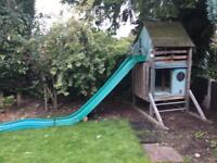 tp Two-levelled tree house with a slide