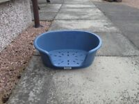 """Small 15"""" blue plastic cat/dog bed."""