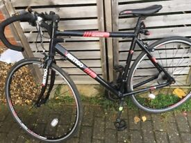 Road bike recently serviced slight rust works well