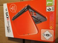 New Nintendo 3DS XL orange and black New and Boxed