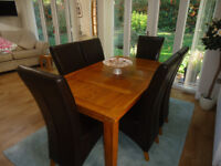 G Plan solid oak dining table and chairs. Excellent as new condition