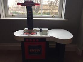Children's kitchen with sound button for hob
