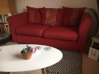 Red DFS sofa with matching tub chair
