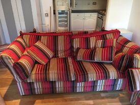 Two striped velvet three-seater sofas