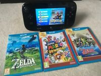 Nintendo Wii U 32gb with 4 premium games including Zelda: Breath of the Wild and Mario Kart 8