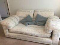Three piece cream sofa and 2 matching arm chairs