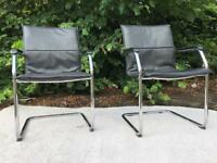 Black leatherette and chrome retro armchairs
