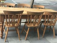 HUGE rustic farmhouse table and chairs table has a drawer either end , good structural condition