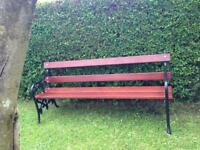 6 foot long stunning cast iron garden bench with solid mahogany straps