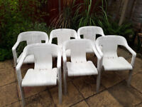 6 white garden chairs