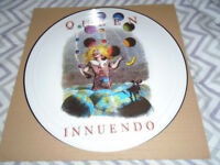 For sale two queen picture discs mint condition