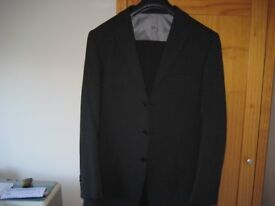 Charcoal grey M&S suit. Jacket 40L trousers 36L very good condition.