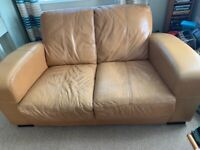 Tan leather sofa. Used condition.