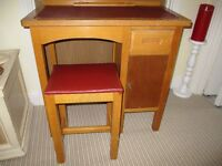 WOODEN DESK AND STOOL.1960S. WITH RED LEATHER TOP AND SEATING.