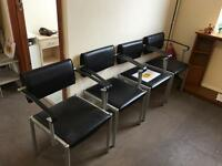 Black/chrome leather armchairs