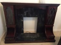 Fire surround- Black granite/ marble with mahogany effect wood