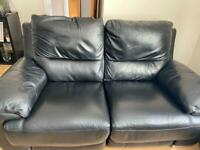 2 x Two seater Black Leather Recliner Sofas