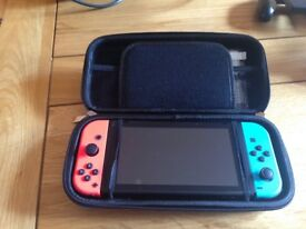 Brand New never used Nintendo Switch and 2 games and a carry case and screen protectors