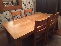 Oak Dining table and 4 chairs for sale with brown leather seat pads. Bargain £150.00