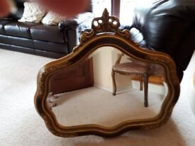 Good heavy mirror in attractive giltwood frame with bevelled glass