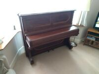 Steinway upright piano.