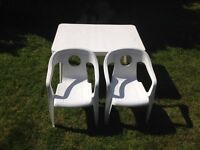 Childrens small plastic table and two white plastic chairs craft picnics